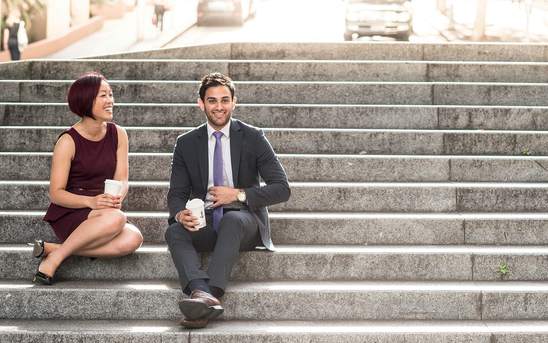 Man and woman sitting on steps
